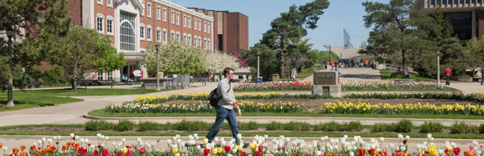 Student walks on Quad near Schroeder Hall