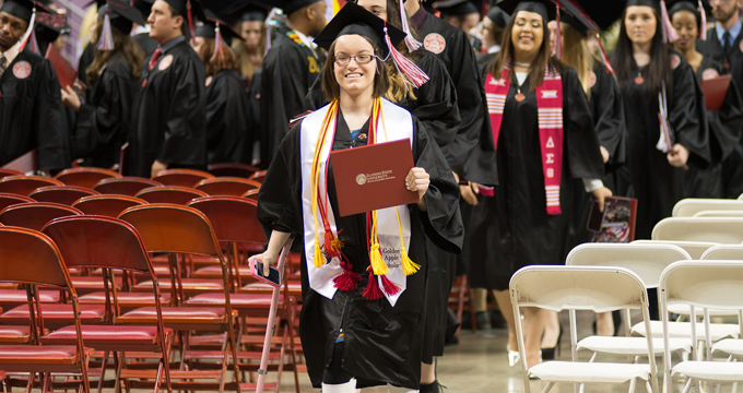 Student walks down aisle at commencement